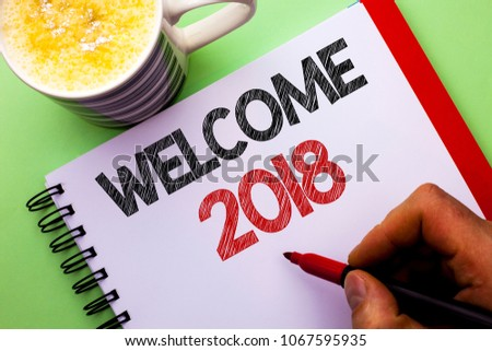 Word writing text Welcome 2018. Business concept for Celebration New Celebrate Future Wishes Gratifying Wish written by Man on Notebook Book Holding Marker on the plain background Coffee Cup #1067595935