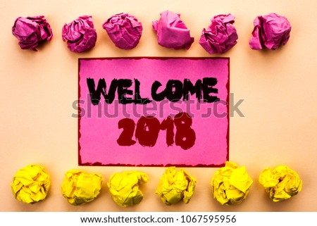 Word writing text Welcome 2018. Business concept for Celebration New Celebrate Future Wishes Gratifying Wish written on Pink Sticky Note Paper on the plain background Paper Balls. #1067595956