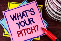 Word writing text What Is Your Pitch Question. Business concept for Present proposal Introducing Project or Product written Pink Sticky Note paper wooden background Cup and Marker next to it