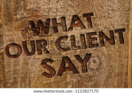 Word writing text What Our Client Say. Business concept for Customers Feedback or opinion about product service Message banner wood information board post plywood natural brown art. #1123827170