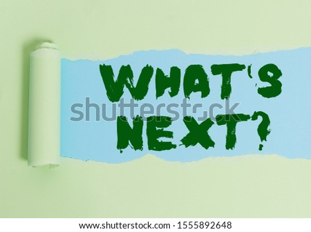 Word writing text What S Next Question. Business concept for asking demonstrating about his coming actions or behaviors Cardboard which is torn in the middle placed above a plain table backdrop. #1555892648
