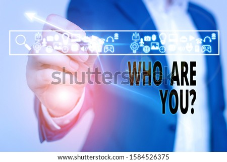 Word writing text Who Are You Question. Business concept for asking about someone identity or demonstratingal information.