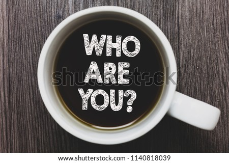 Word writing text Who Are You question. Business concept for Identify yourself description personal characteristics Black coffee with coffee mug floating texts on gray black wooden desk.