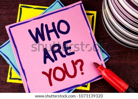 Word writing text Who Are You Question. Business concept for Introduce or Identify Yourself Tell your Personal Story written Pink Sticky Note paper wooden background Cup and Marker next to it #1073139320