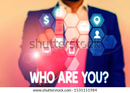 Word writing text Who Are Youquestion. Business concept for someone asking your demonstratingal background or history.