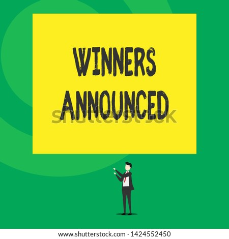 Word writing text Winners Announced. Business concept for Announcing who won the contest or any competition Isolated view young man standing pointing upwards two hands big rectangle.