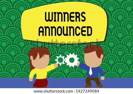 Word writing text Winners Announced. Business concept for Announcing who won the contest or any competition Standing young couple sharing gear. Man tie woman skirt commerce relation.