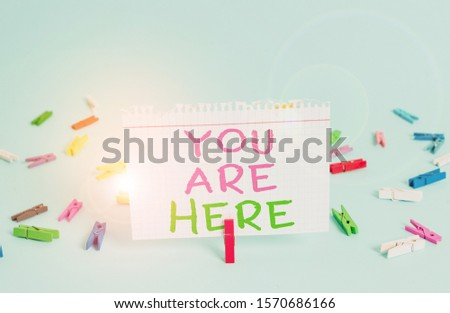 Word writing text You Are Here. Business concept for This is your location reference point global positioning system Colored clothespin rectangle square shaped paper light blue background. #1570686166
