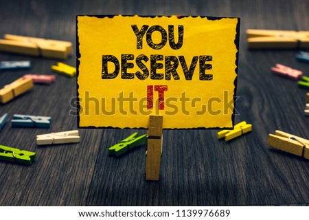 Word writing text You Deserve It. Business concept for Reward for something well done Deserve Recognition award Blacky wooden desk laid paper clip randomly one hold yellow board with text. #1139976689