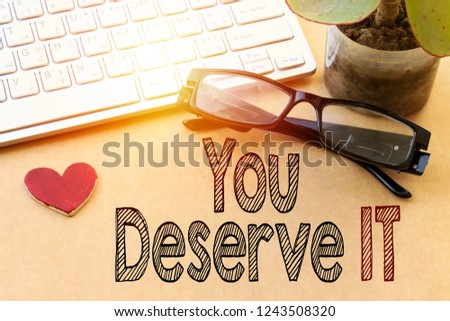 Word writing text You Deserve It. Business concept for Reward for something well done Deserve Recognition award, white keyboard and eyeglasses, pot plant  #1243508320