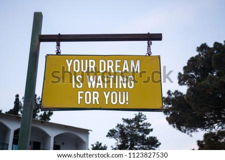 Word writing text Your Dream Is Waiting For You. Business concept for Goal Objective Intention Target Yearning Plan Wooden board hang hanging post ideas messages feelings trees blue sky. #1123827530