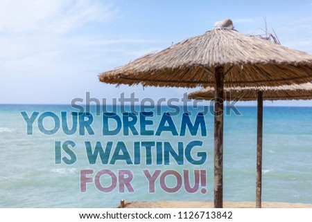 Word writing text Your Dream Is Waiting For You. Business concept for Goal Objective Intention Target Yearning Plan Blue beach water Thatched Straw Umbrellas Message Ideas Thoughts Reflection. #1126713842