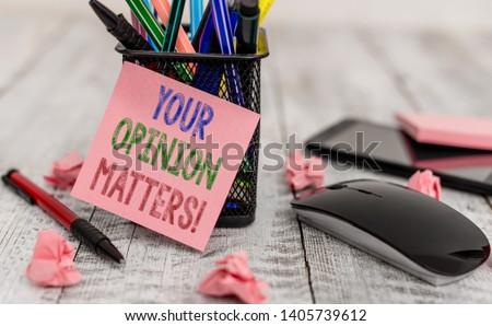Word writing text Your Opinion Matters. Business concept for show you do not agree with something that just been said Writing equipment and paper plus scraps with gadgets on the wooden desk.