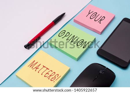 Word writing text Your Opinion Matters. Business concept for show you do not agree with something that just been said Note papers and stationary plus gadgets placed sideways above backdrop.