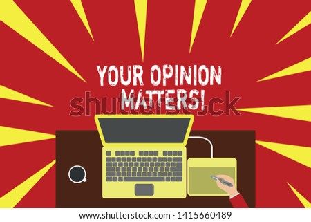 Word writing text Your Opinion Matters. Business concept for show you do not agree with something that just been said Upper view laptop wooden desk worker drawing tablet coffee cup office.