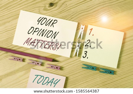 Word writing text Your Opinion Matters. Business concept for show you do not agree with something that just been said Colored clothespin papers empty reminder wooden floor background office.