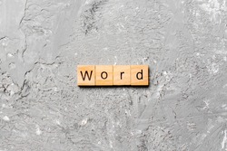 word written on wood block. WORD text on cement table for your desing, concept.