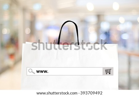 Word www. on search bar over shopping bag and blur store background, online shopping background, business, E-commerce, web banner