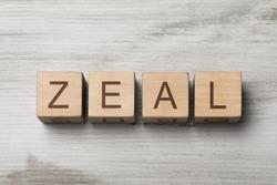 word ZEAL written on wooden cubes