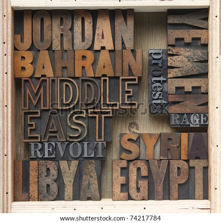 words associated with uprisings in the Middle East in old wood type
