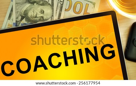 Words coaching  on tablet. Business concept.