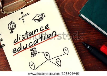 Words distance education written in the notepad.