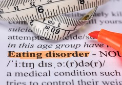Words eating disorder with highlighter and measuring tape
