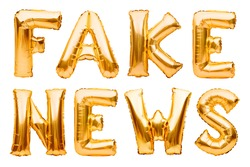 Words FAKE NEWS made of golden inflatable balloons isolated on white background. Helium balloons gold foil forming word news. Startup, grand opening celebration. Business beginnings event concept.