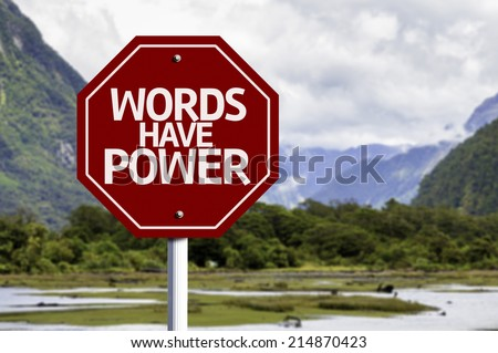 Words Have Power red sign with a landscape background