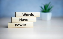 Words Have Power word cube on blue background ,English language learning concept