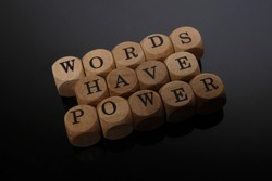 Words Have Power word cube on wood background