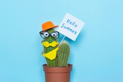 Words Hello Summer and funny cactus on the blue background.