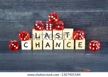 Words Last chance written on wooden cubes and red dice on the dark background.  #1307405584