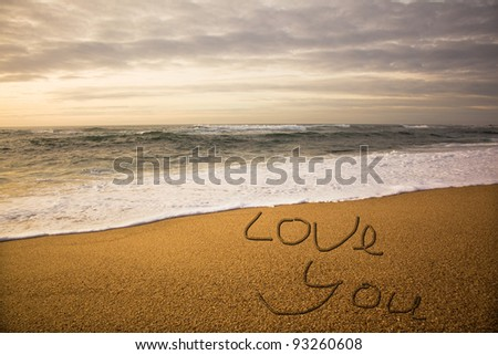 Words Love You on beach - vacation concept background