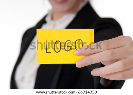 Words on business card holding by Asian businesswoman.