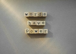 words  Words Have Power written in  wooden alphabet letters isolated on an craft paper - carton background with empty copy space. ray of sunshine.