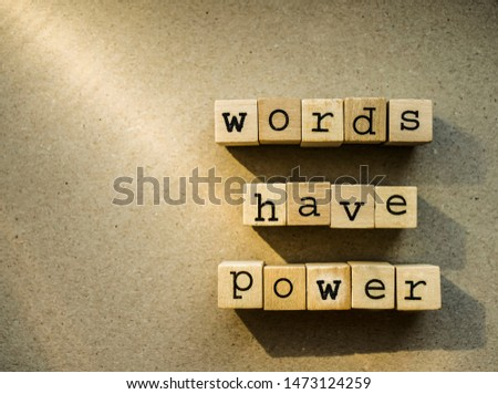 words  Words Have Power written in  wooden alphabet letters isolated on an craft paper - carton background with empty copy space. ray of sunshine #1473124259