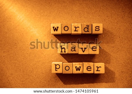 words  Words Have Power written in  wooden alphabet letters isolated on an craft paper - carton background with empty copy space. ray of sunshine #1474105961