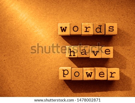 words  Words Have Power written in  wooden alphabet letters isolated on an craft paper - carton background with empty copy space. ray of sunshine