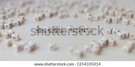 Words WORDS HURT made of wooden cubes with letters #1254335014