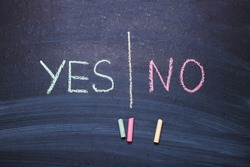 Words yes no on chalk board. The concept of choice, decision, consent, denial