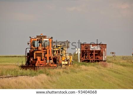 Work and ore rail cars parked on unused railroad tracks
