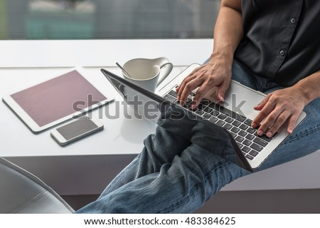 Work and stay at home concept with blog writer or business person casual digital lifestyle using smart device working online from home on internet communication technology