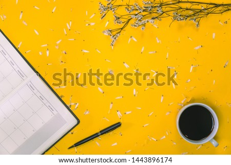Work area Concept of coffee cups with notes book and pens with white flowers placed on the table on the floor Pastel yellow Top view Placed flat Summer, education, modern, read a book, book, Write  Сток-фото ©