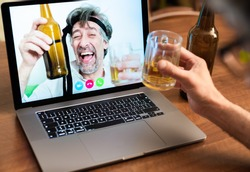 Work colleagues celebrate success by getting drunk on beers on long-distance video calls, friends lift their elbows during a video call