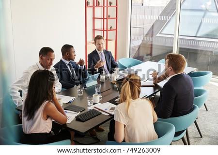 Work colleagues having a meeting in boardroom