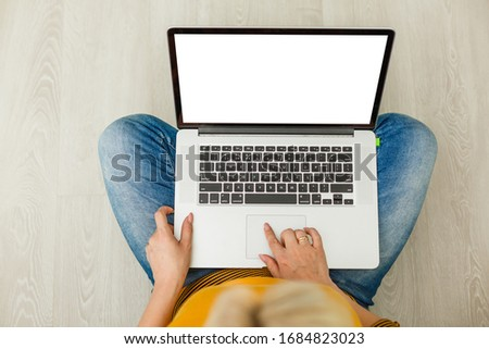 Work during quarantine, a woman at home works on the laptop