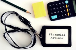 work equipment (pencil,sticky note,calculator) and an staff ID card holder  with title text FINANCIAL ADVISOR, a professional financial services provider to clients based on their financial situation