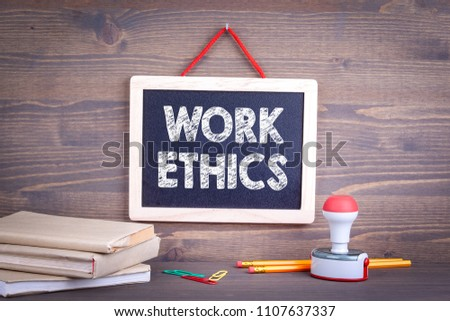 Work ethics, Business Concept. Chalkboard on a wooden background #1107637337