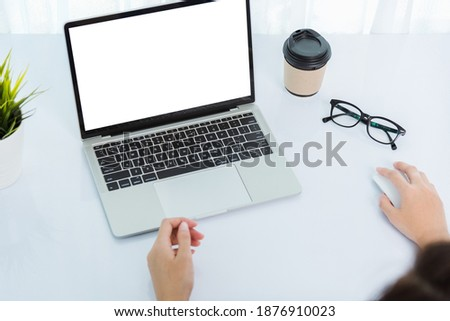 Work from home, Back of Asian young businesswoman video conference call or facetime meeting online on front laptop computer quarantines disease coronavirus or COVID-19 at home office
